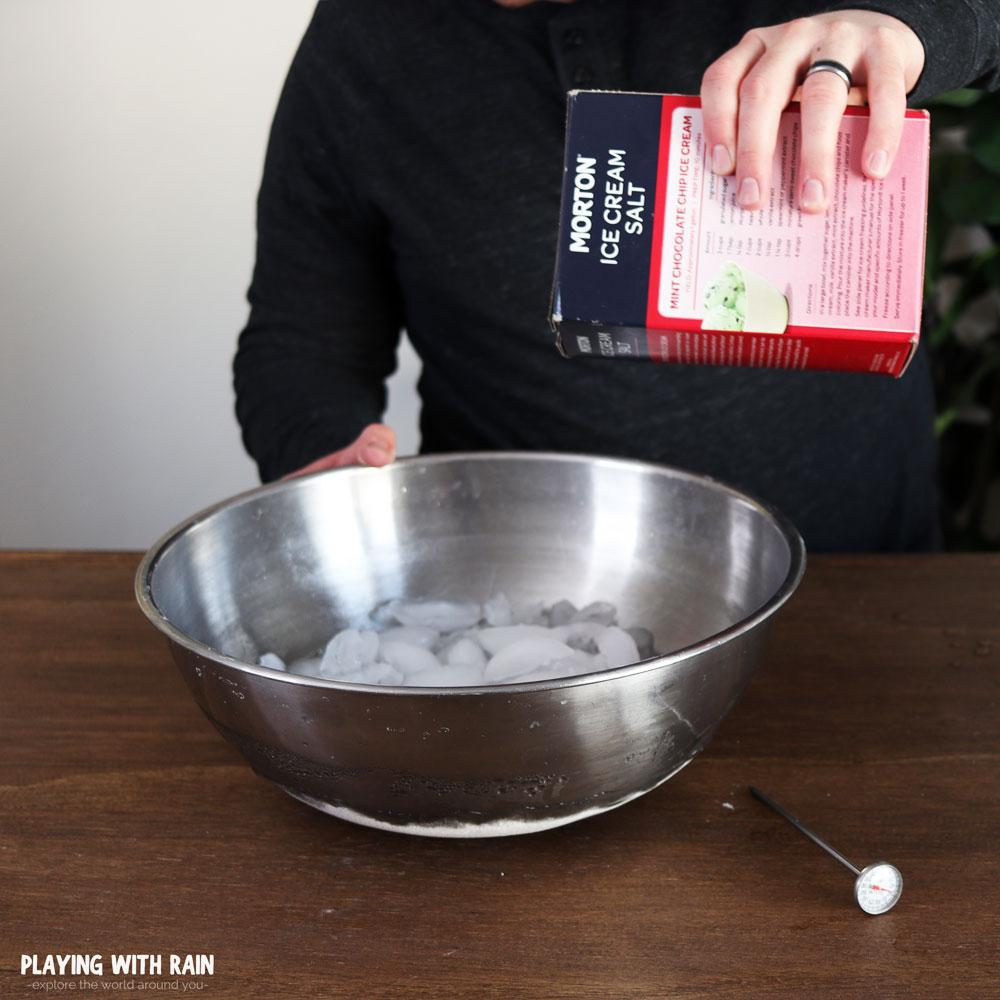 pour rock salt into ice