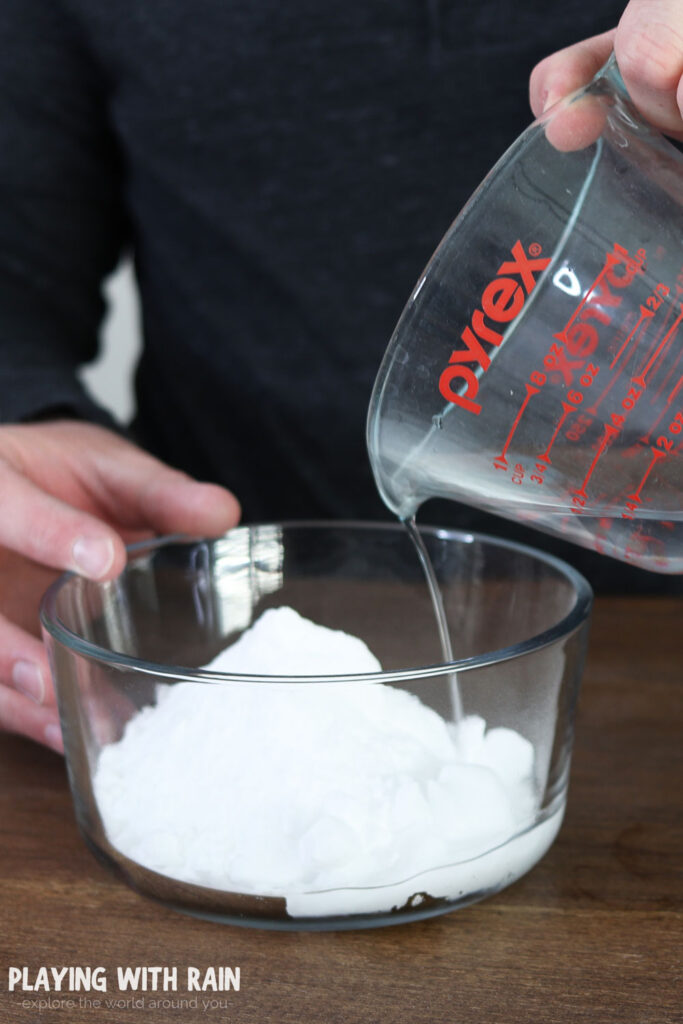 Add water to the bowl of baking soda