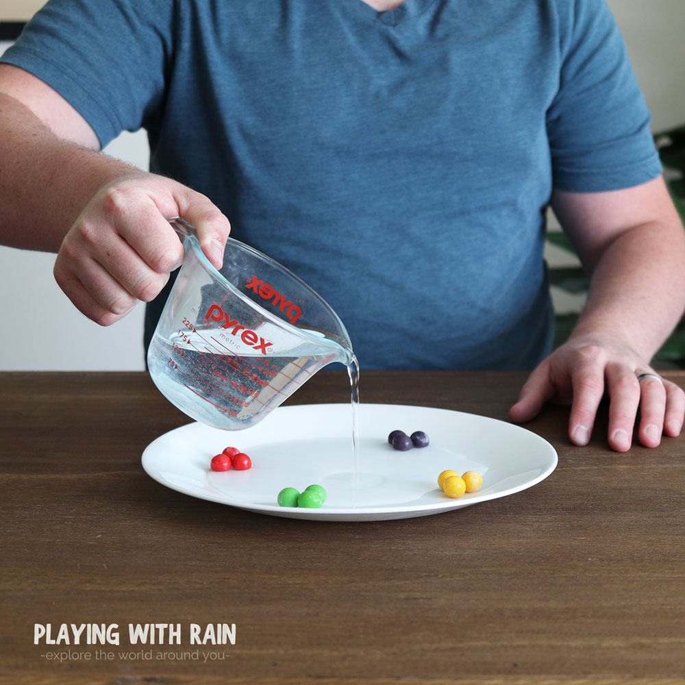Pour water onto the plate with the Gobstoppers