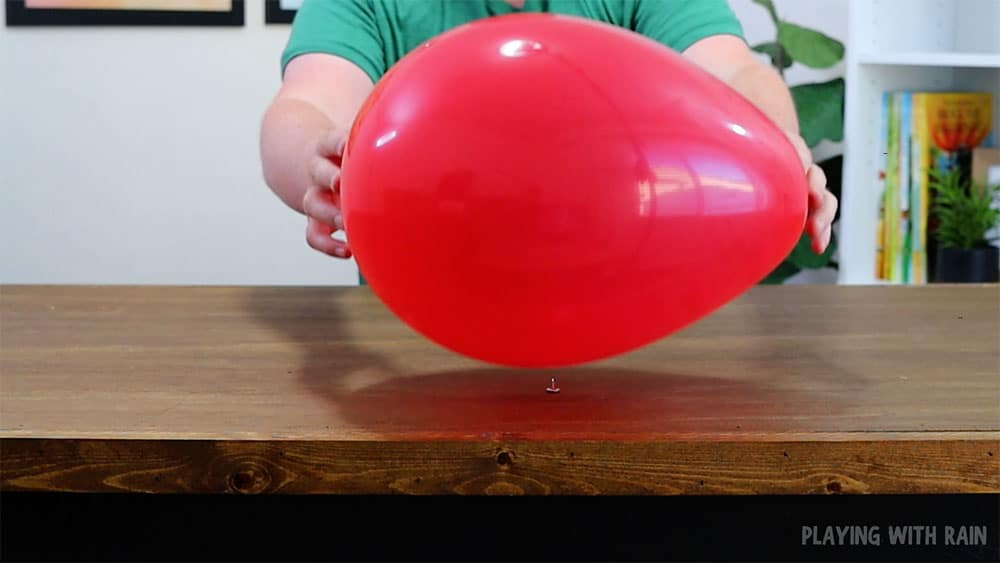 Place a balloon on a pin and see if it pops