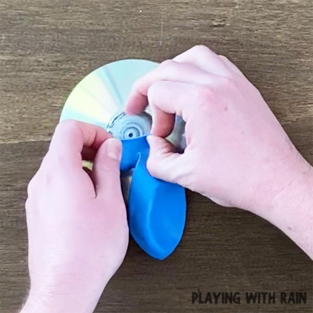 Slide the balloon over the cap