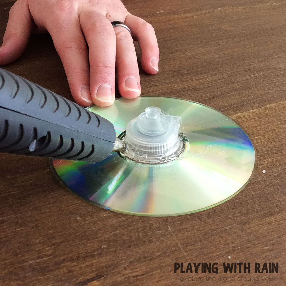 Use hot glue to attach the cap to the CD