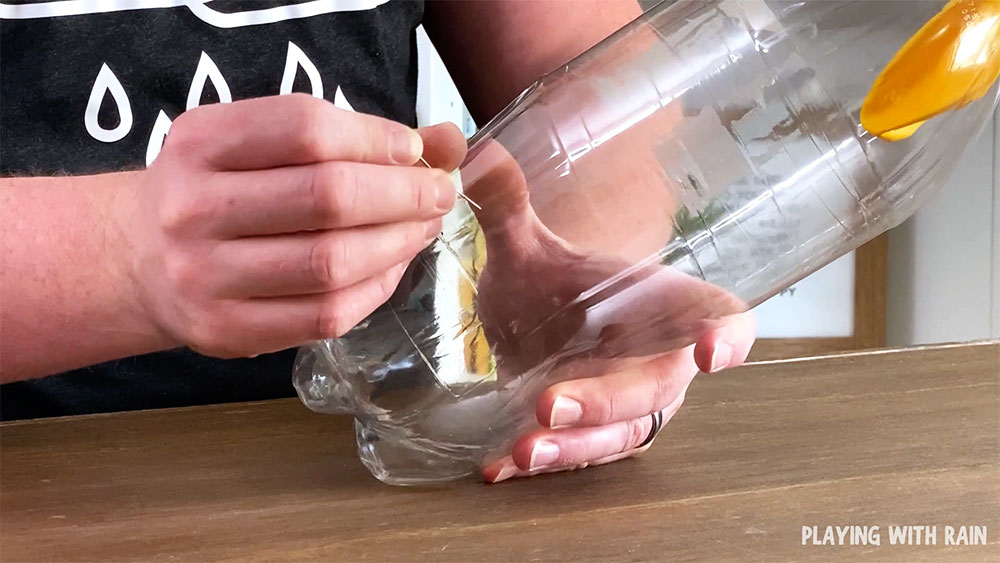 Poke a small hole in the bottle