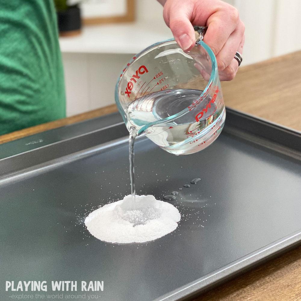 pour water onto the snow powder