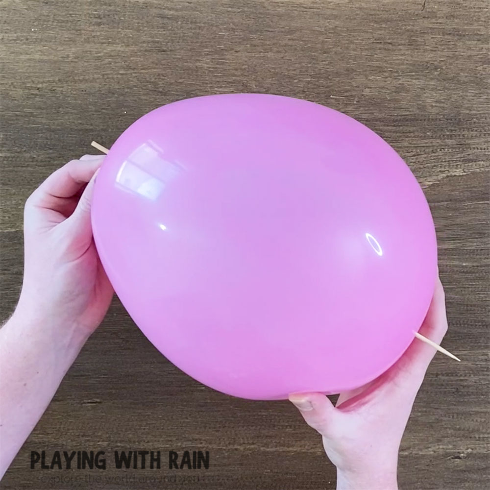 The skewer goes through the balloon without popping