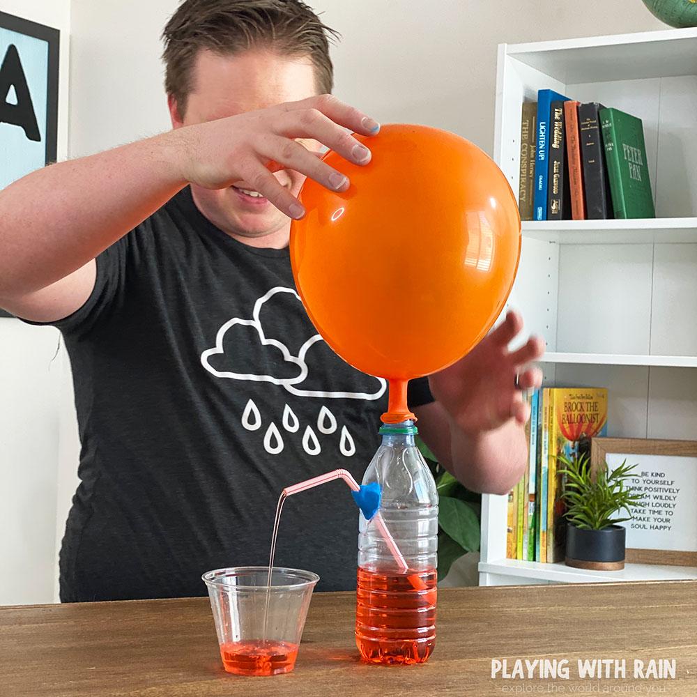 Balloon powered water dispenser