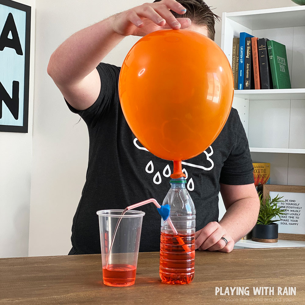 Untwist balloon neck and let air push into bottle