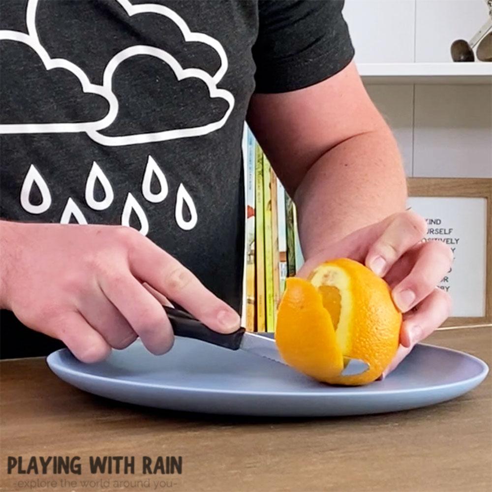 Carefully cut an orange peel