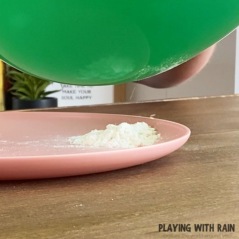 Flour attracted to negative charged balloon