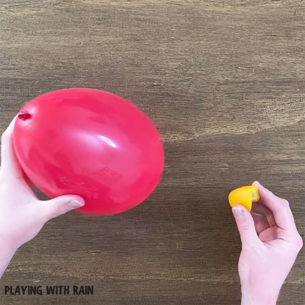 You only need an orange and a balloon