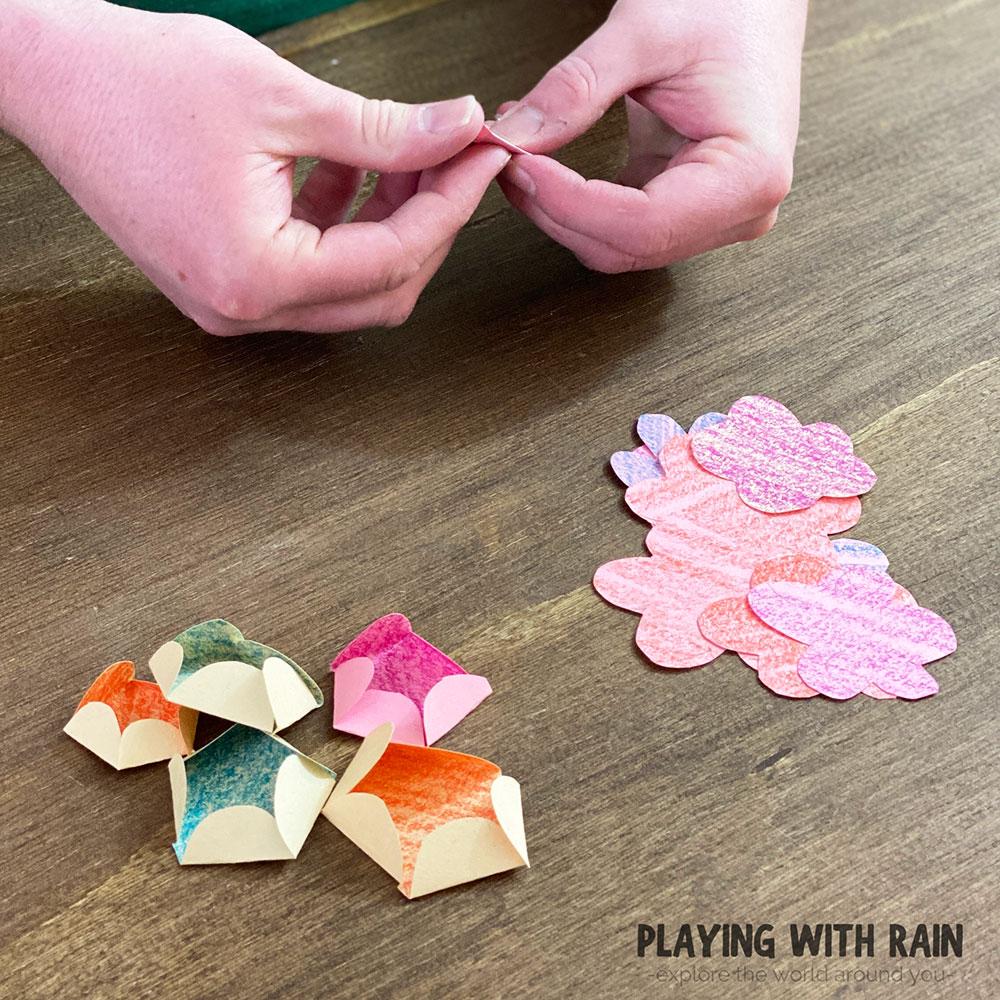 Folding paper flower petals