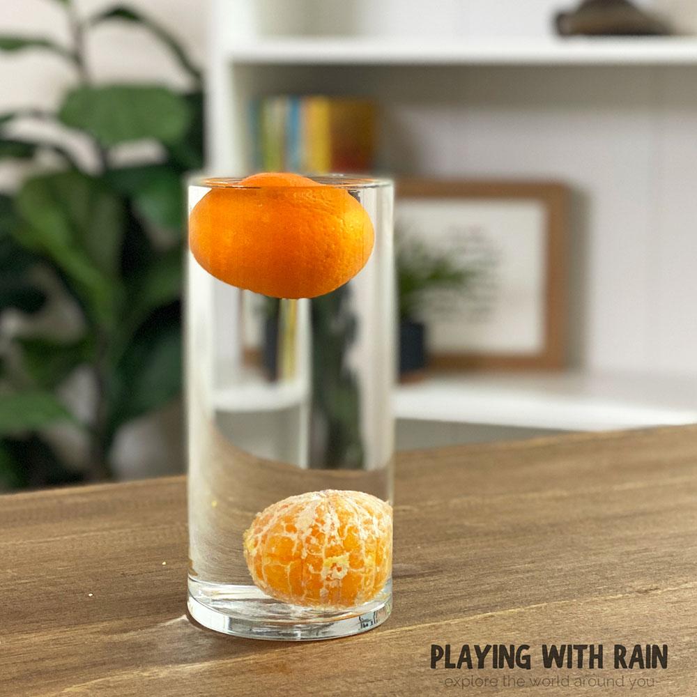 Unpeeled orange floats in water