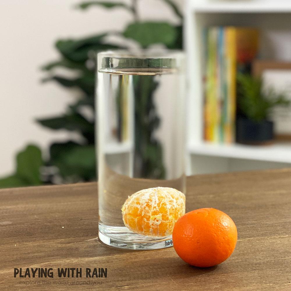 Peeled orange sinks in water