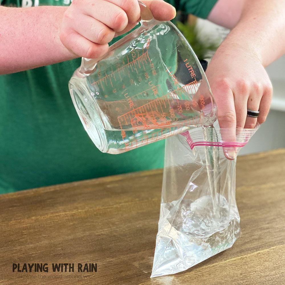 Pour water into a plastic zipper bag