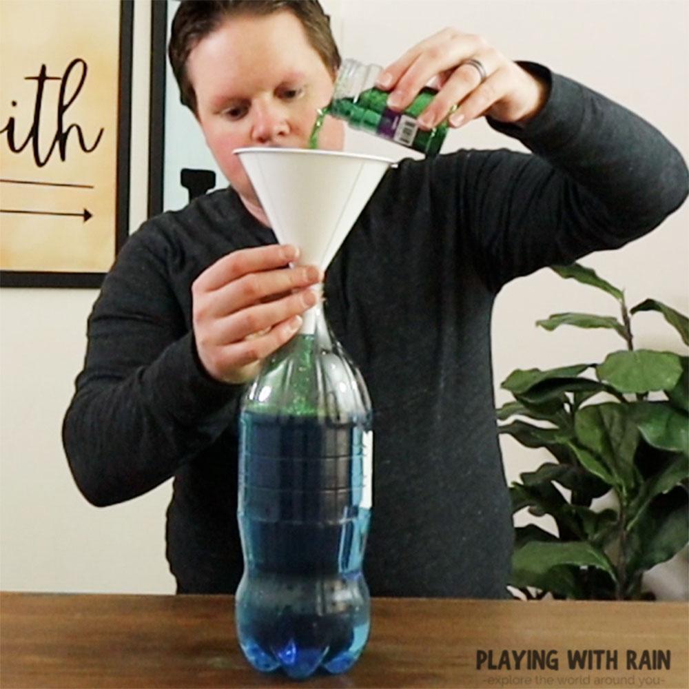 Pour glitter into the bottle for tornado debris