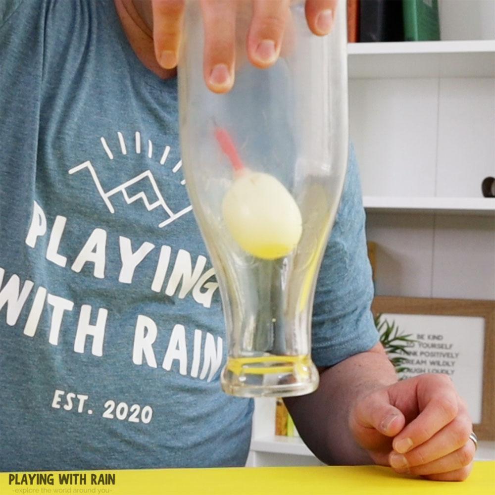 Egg in an upside-down bottle trick