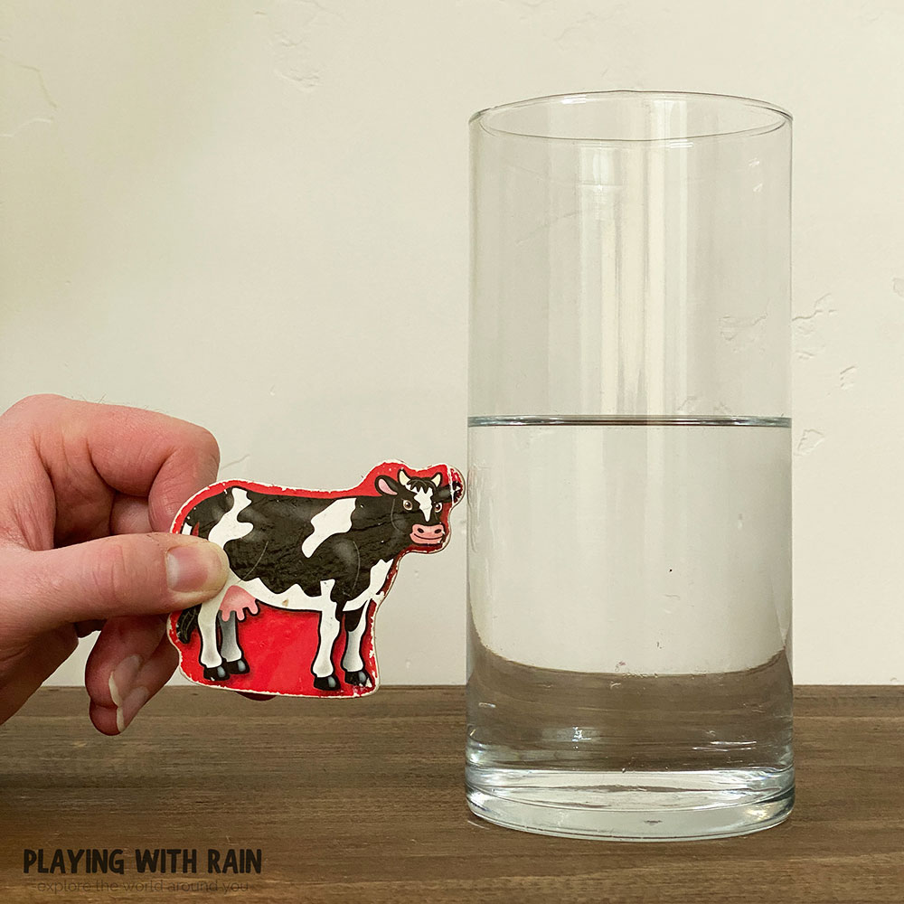 Hold an image off to the side of the glass of water