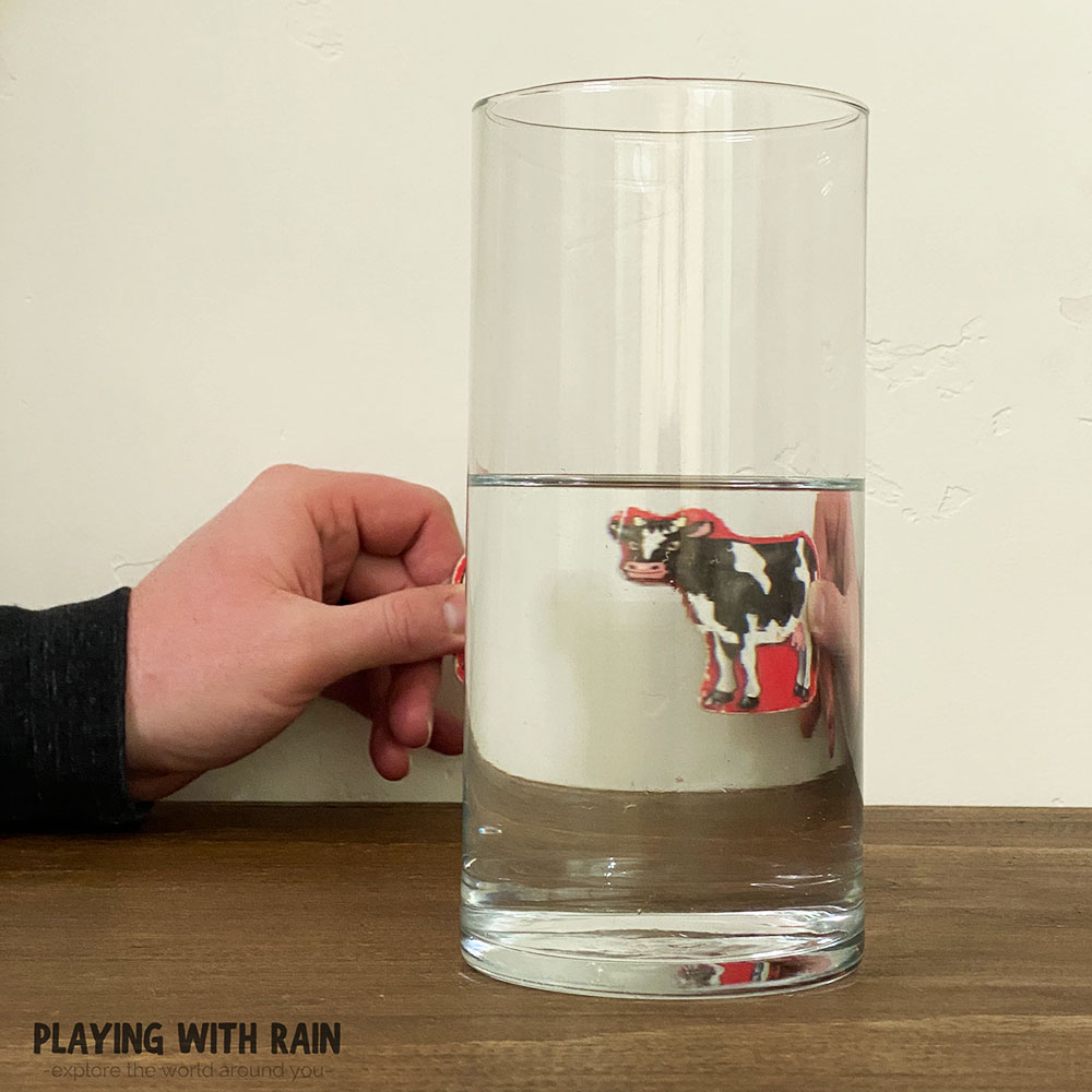 Slide the image behind the glass of water