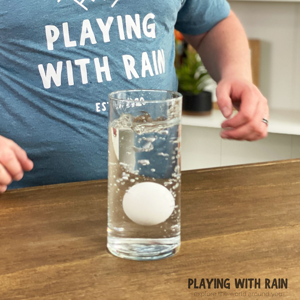 Egg splashing into a glass of water
