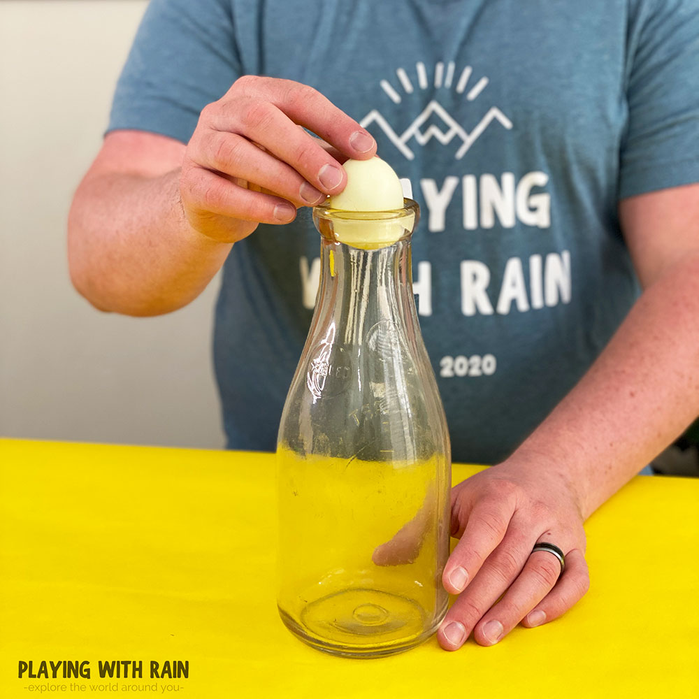 Try pushing the egg into the bottle