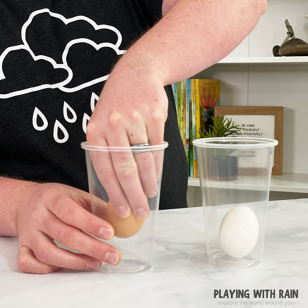 Gently place an egg inside a cup
