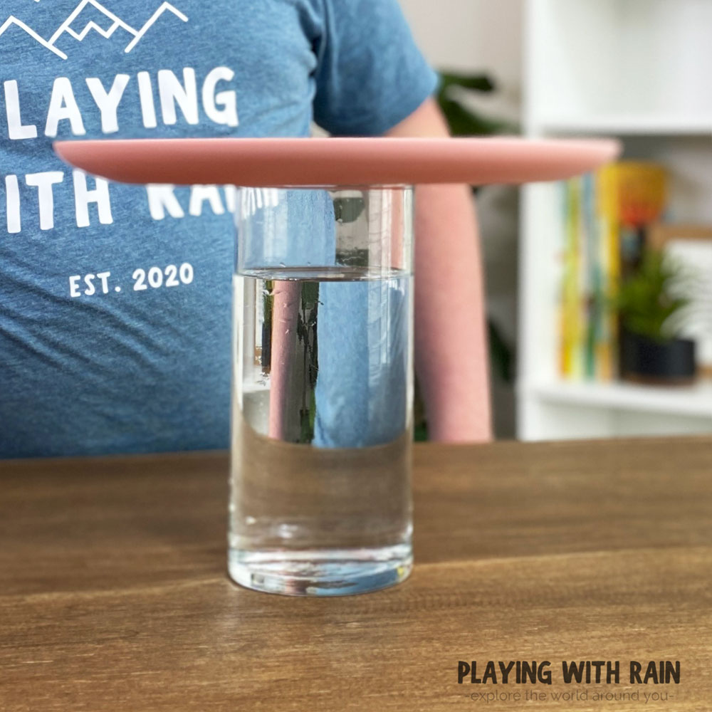 Set a plate on top of a cup of water