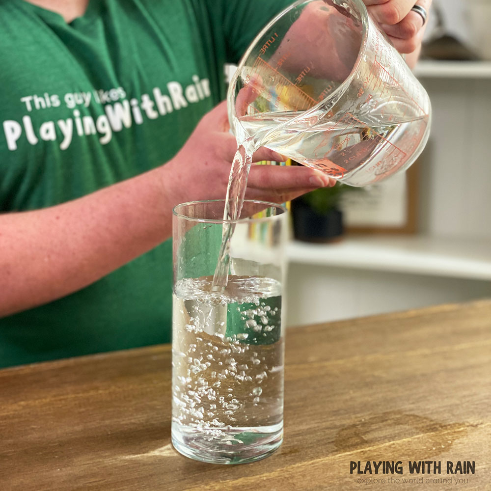Fill a cup all the way to the brim with water