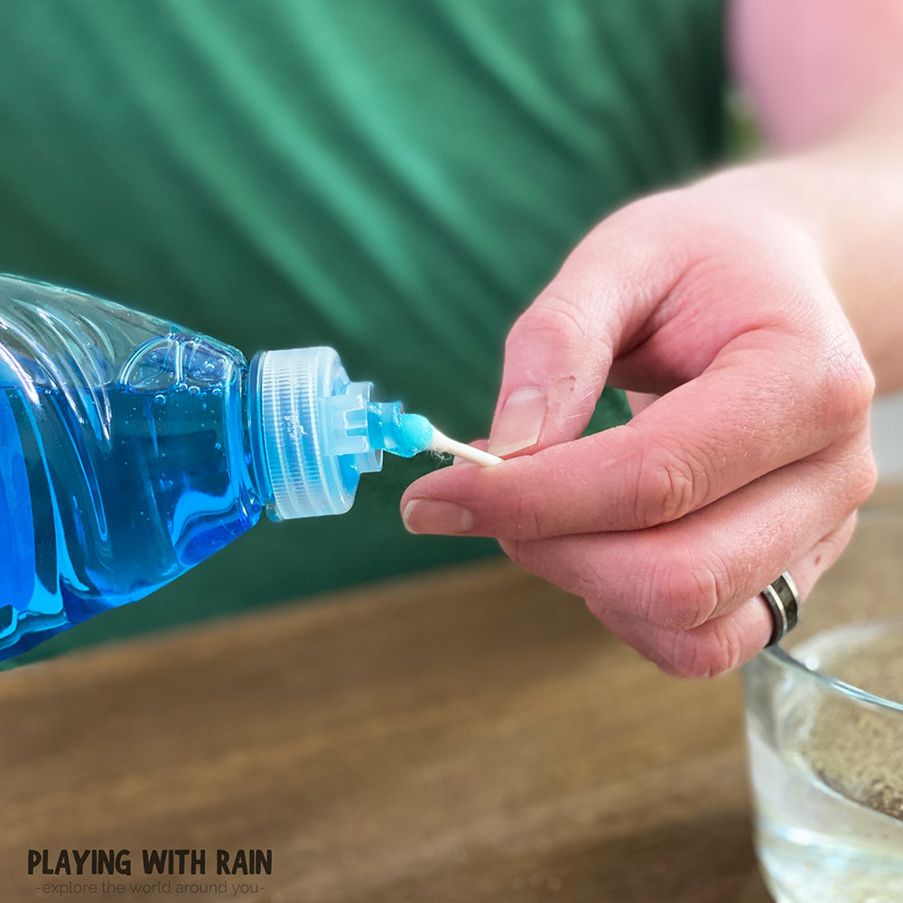 Put a drop of soap on a cotton swab