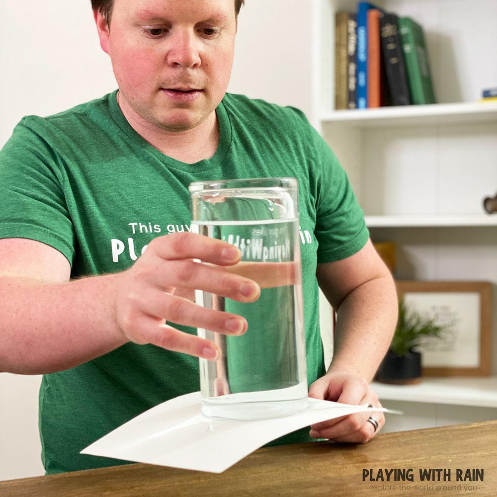 Water stays inside an upside down glass