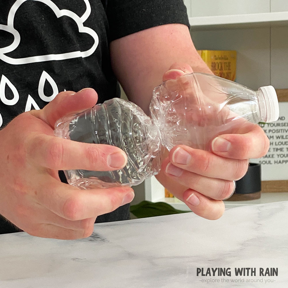 Twisting the bottle up to increase the air pressure