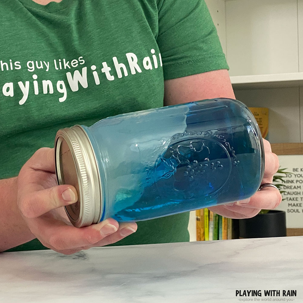 Rocking the jar back and forth to make waves