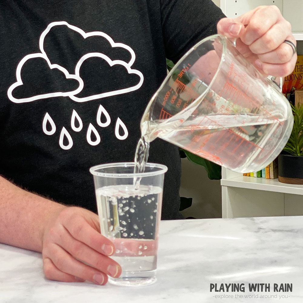 Pour water into a cup