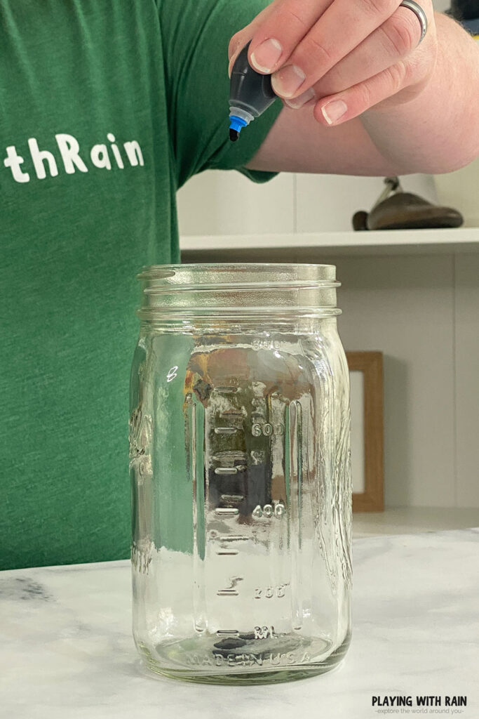 Putting a few drops of food coloring into an empty jar
