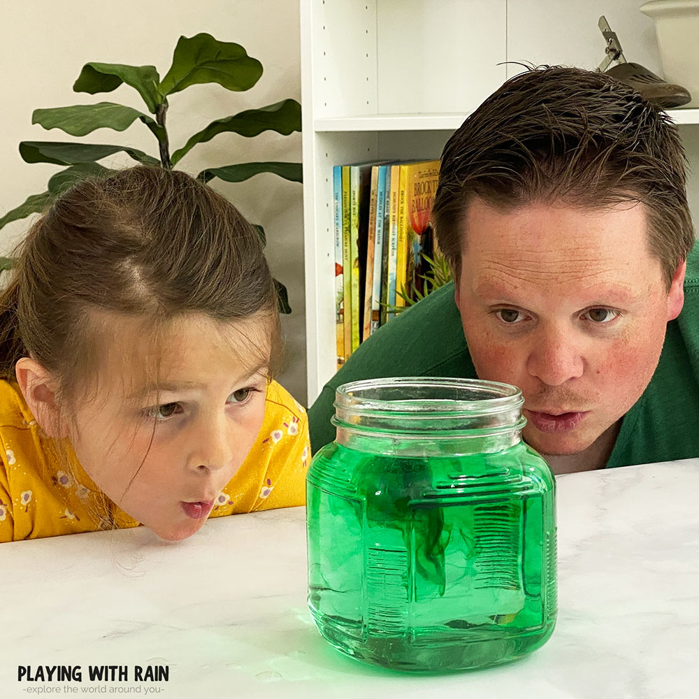 Food coloring swirling in a jar or water like a hurricane