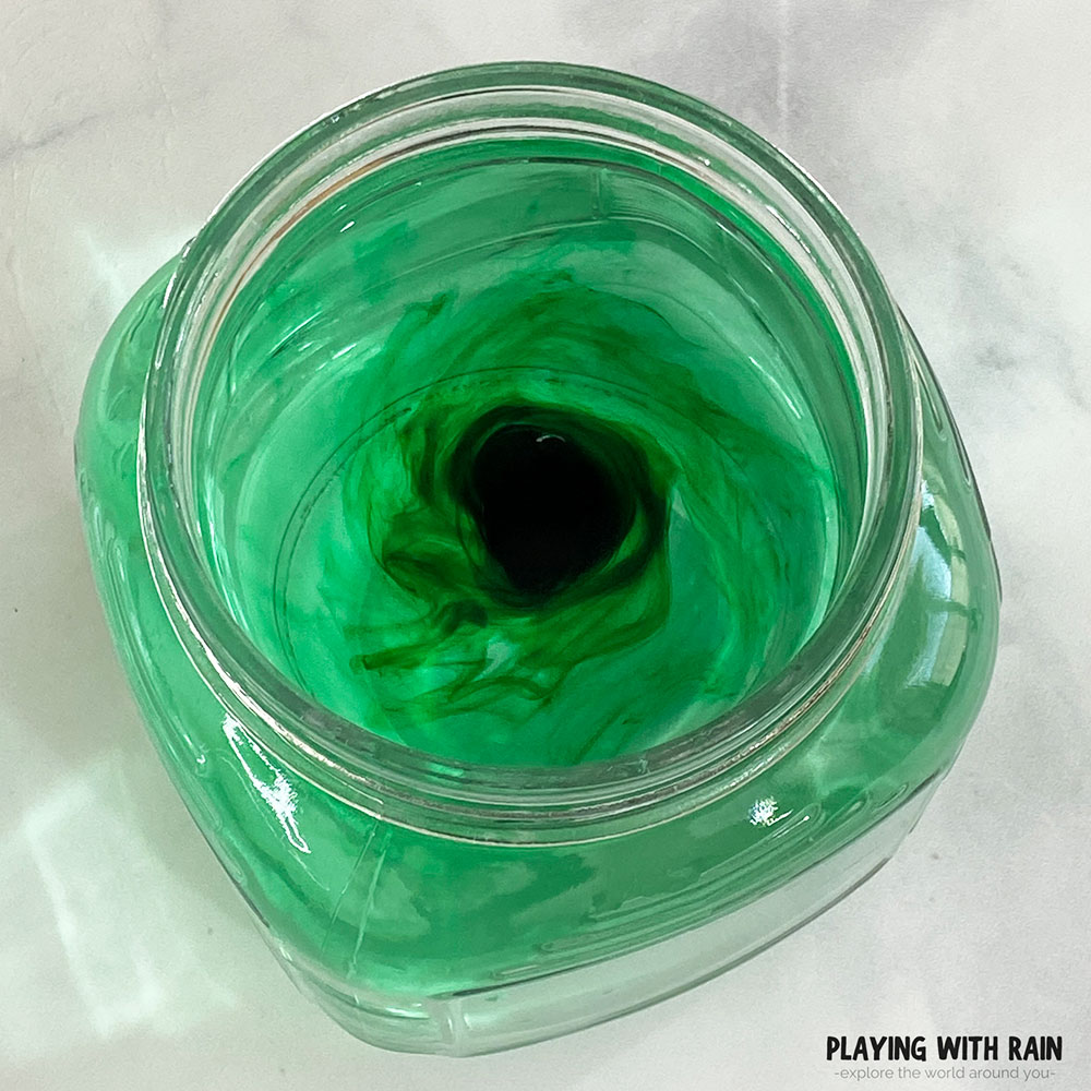 Food coloring and water spinning in a jar